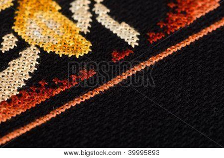 Dark cross stitching