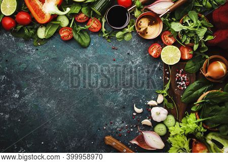 Fresh Helthy Food Cooking Or Salad Making Ingredients On Dark Background With Rustic Wooden Board. D