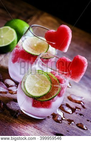 Watermelon Lime Lemonade With Ice In Glasses, Decorated With Fruit Hearts, Vintage Wooden Background
