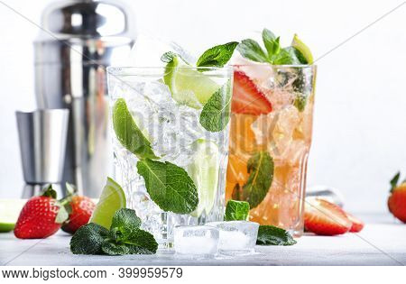 Fresh Mojito Cocktail Set With Lime, Mint, Strawberry And Ice In Glass On Gray Background. Summer Co