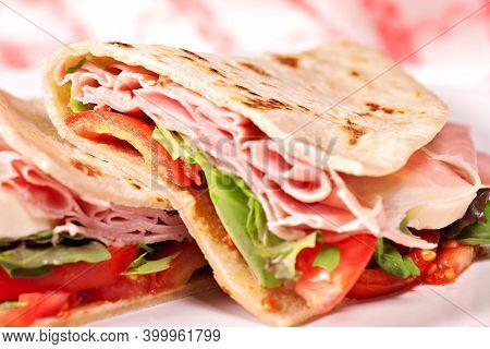 Traditional Italian Piadina With Ham, Cheese, Tomato And Salad.