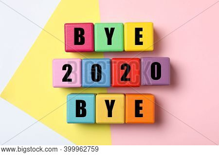 Cubes With Phrase Bye 2020 Bye On Color Background, Flat Lay