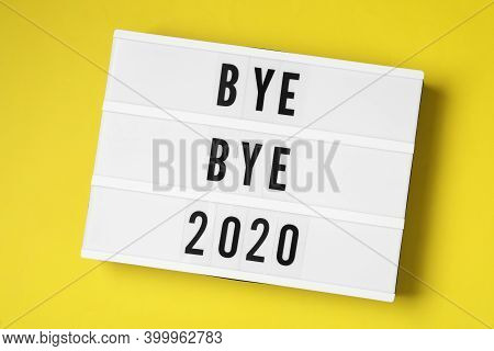 Lightbox With Text Bye Bye 2020 On Yellow Background, Top View