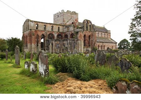 Vintage priory with graves