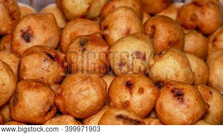 Deep fried traditional Indian dish called poornalu made with jaggery
