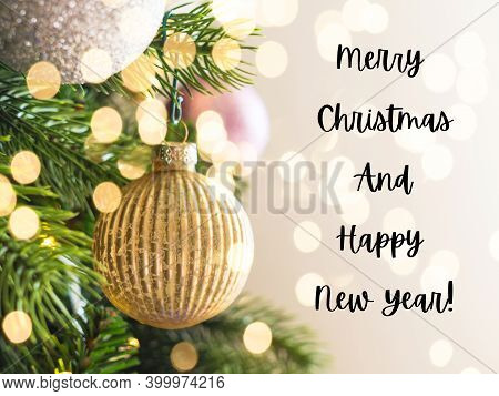 New Year Christmas Tree Festive Greeating Card With Golden Ornaments And Holiday Lights Bokeh. Text
