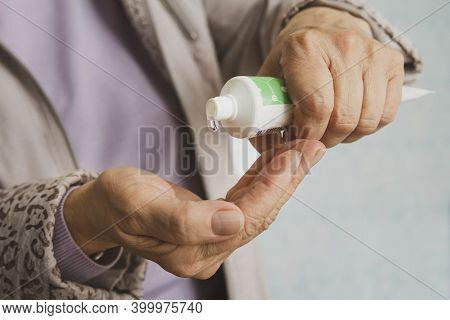 Woman Disinfects His Hands With Alcohol Gel To Protect Them From Viruses And Bacteria. Antibacterial