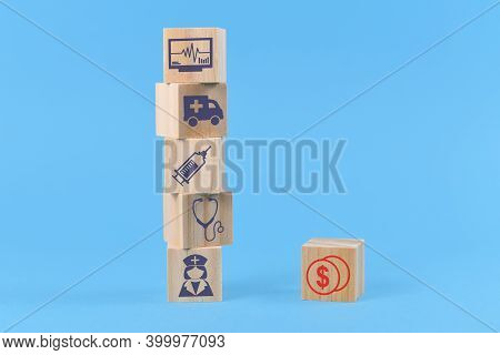 Concept For Discrepancy Between Costs For Medical Treatments And Funding Depicted With Wooden Blocks