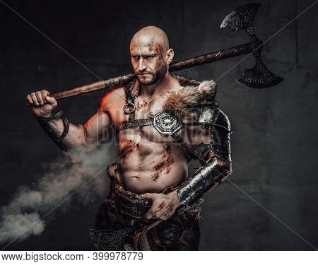 Portrait Of A Furious Viking Warrior With Grimy And Bloody Skin In Light Armour In Dark Smokey Backg
