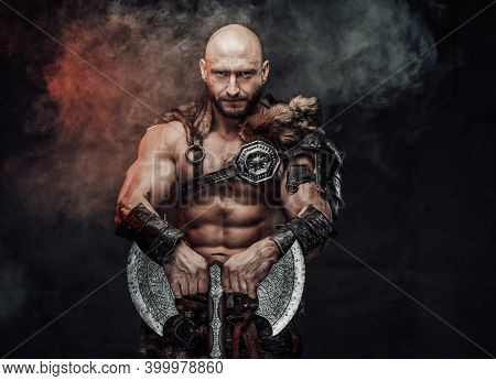 Powerful And Shirtless Viking Warrior With Bald Head Dressed In Steel Lights Armour With Fur Poses I