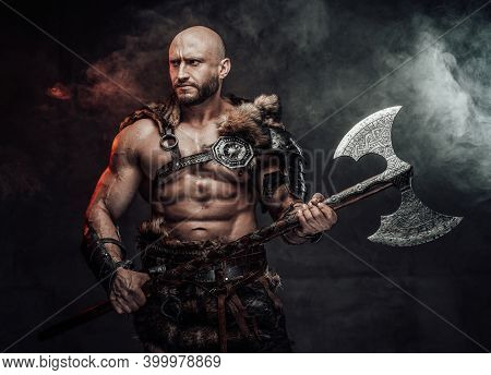 Dressed In Antique Light Armour With Fur Bald And Violent Viking With Muscular Build Poses In Dark A