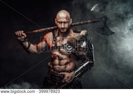Portrait Of A Furious Viking Warrior With Grimy And Bloody Skin Dressed In Light Armour In Dark Smok