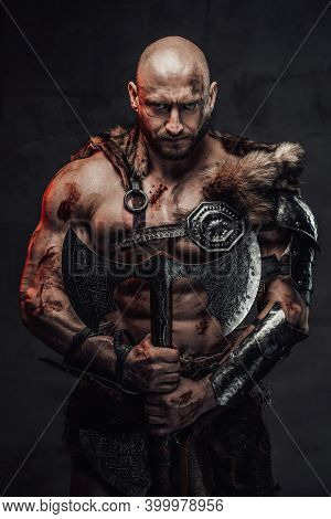 Serious And Furious Scandinavian Barbarian With Bald Head And Grimy And Bloody Skin In Armour With F