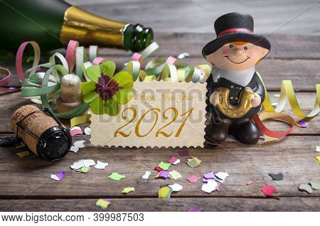 Chalkboard With Four Leaf Clover And Chimney Sweeper And Sparklers With Happy New Year 2021 On Woode