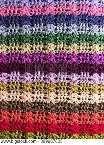 Full Frame Close Up Of The Complex Stitching Of A Multicoloured Crochet Blanket