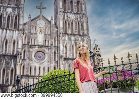 Young Woman Tourist On Background Of St Josephs Cathedral In Hanoi. Vietnam Reopens After Coronaviru