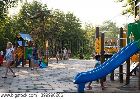 Little Children With Their Parents Play In Playground. Family Vacation In Summer. Kerch, Russia - Ju