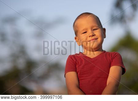 Outdoor portrait of cute little smiling boy