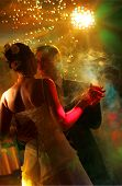 Newlywed couple dancing at their wedding reception. poster