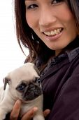 pleased woman with cute puppy on an isolated background poster