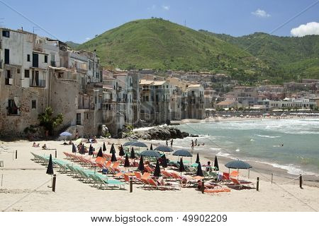 Cefalu beach and houses along the shoreline, Sicily