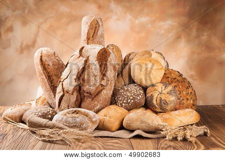 Various kind of bread on wooden surface