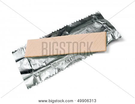 Chewing gum on the wrapping foil isolated on white