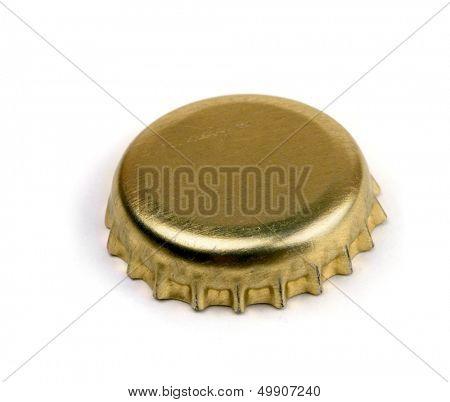 Golden bottle cap  isolated on white