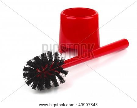 Red plastic toilet brush isolated on white