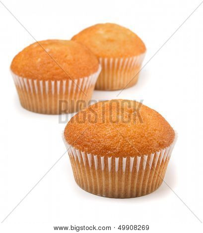 Three cupcakes with fruit filling isolated on white