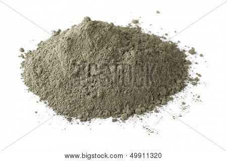 Pile of dry grey portland cement isolated on white