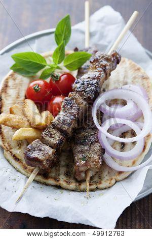 greek style pita bread with meat skewers (souvlaki)