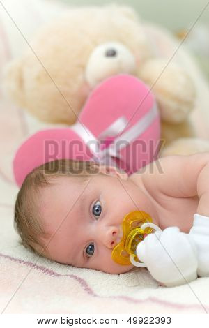 1 month old baby with pacifier