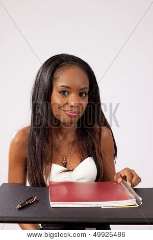 Black woman with red notebook
