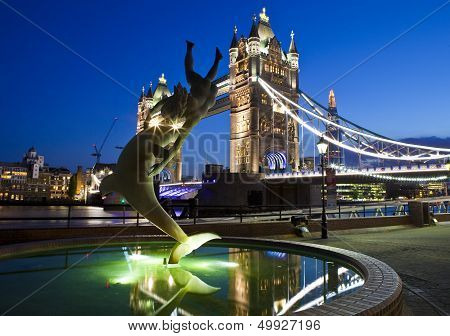 The magnificent Tower Bridge and 'Girl with a Dolphin' statue in London. The Shard can be seen in the background. poster