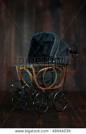 Antique Infant Baby Cradle on Grunge Wooden Background