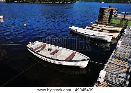 Small Boats At A Jetty.