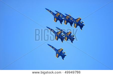 All six Navy FA-18 Blue Angels flying in a precision pattern