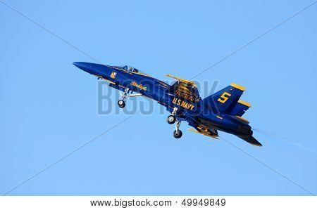 A Blue Angel FA-18 Hornet jet plane in flight