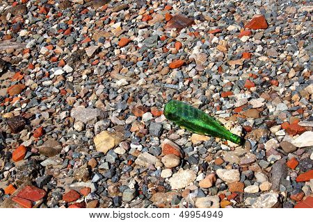 Abstract Grey Red Stones And Green Bottle
