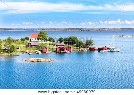 Small Village With Red Buildings In Finnish Archipelago