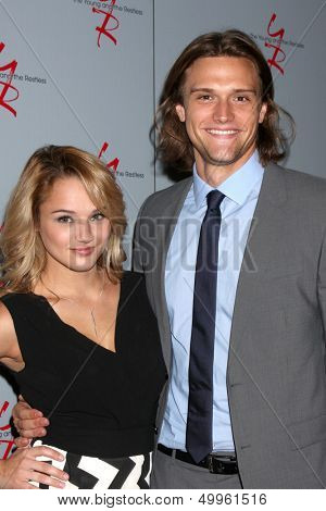 LOS ANGELES - AUG 24:  Hunter King, Hartley Sawyer at the Young & Restless Fan Club Dinner at the Universal Sheraton Hotel on August 24, 2013 in Los Angeles, CA