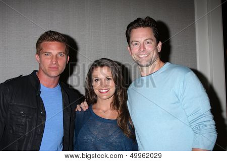 LOS ANGELES - AUG 24:  Steve Burton, Melissa Claire Egan, Michael Muhney at the Young & Restless Fan Club Dinner at the Universal Sheraton Hotel on August 24, 2013 in Los Angeles, CA