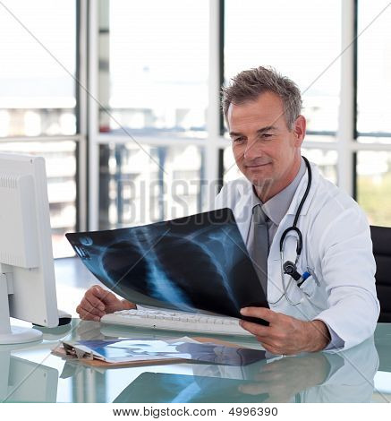 Senior Mature Doctor Working