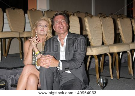 LOS ANGELES - AUG 24:  Melody Thomas Scott, Peter Bergman watching the Jeanne Cooper tribute at the Young & Restless Fan Dinner at the Universal Sheraton Hotel on August 24, 2013 in Los Angeles, CA