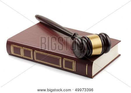 Wooden gavel and book isolated on white
