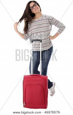Young Woman Alone Waiting With a Red Suitcase