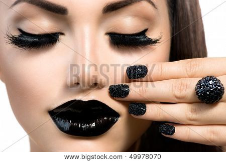 Beauty Fashion Model Girl with Black Make up, Long Lushes. Fashion Trendy Caviar Black Manicure. Nail Art. Dark Lipstick and Nail Polish poster