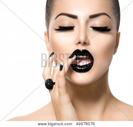 Beauty Fashion Model Girl with Black Make up, Long Lushes. Fashion Trendy Caviar Black Manicure. Nail Art. Dark Lipstick and Nail Polish