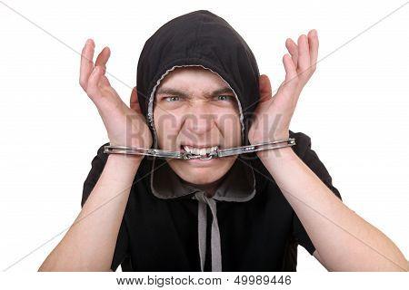 Man Gnaw A Handcuffs
